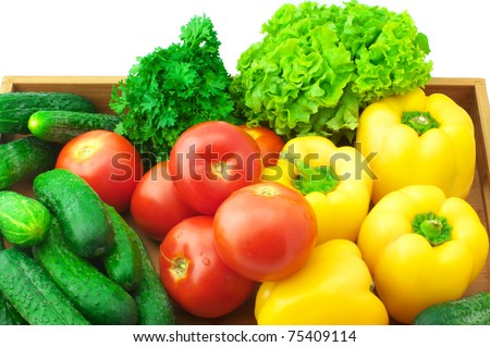 Various fresh vegetables in wooden tray on white background.. - stock photo