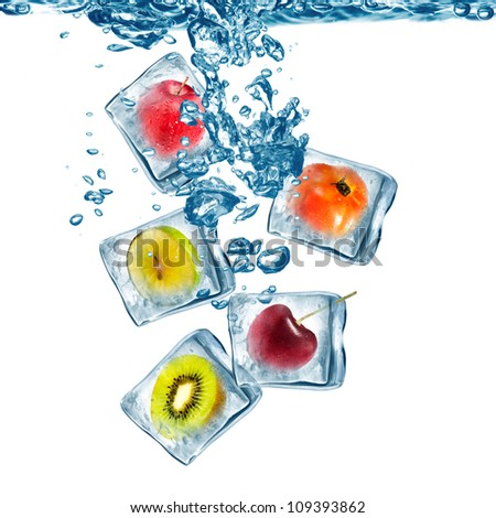 Various Fruit frozen in ice cube drop on water with water bubble - stock photo