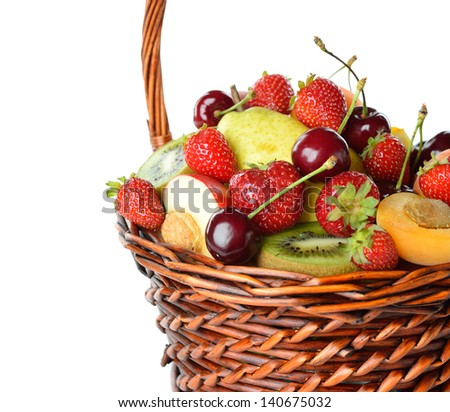 Various fruit in a brown basket isolated on white background