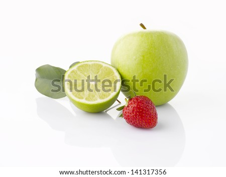Various fruits (Green apple, lime, strawberries) with leaf, isolated on the white background with soft shadow - stock photo