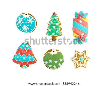various gingerbread cookies on white background - snowflake, bell, fir tree, candy shapes - stock photo