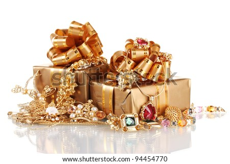 Various gold jewellery and gifts isolated on white - stock photo