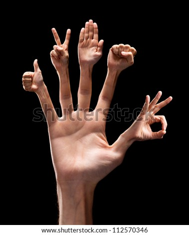 Various hand signs on each finger. Isolated on black - stock photo