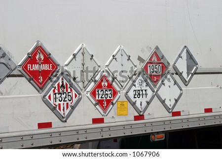 various hazard plackards on the side of a truck - stock photo