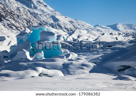 Various ice patterns and hues of blue in glacial ice in a remote area of Alaska - stock photo