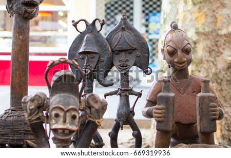 Various interesting masks and figures of African culture in the flea market.