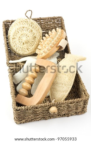 Various items for a massage in a basket on a white background - stock photo