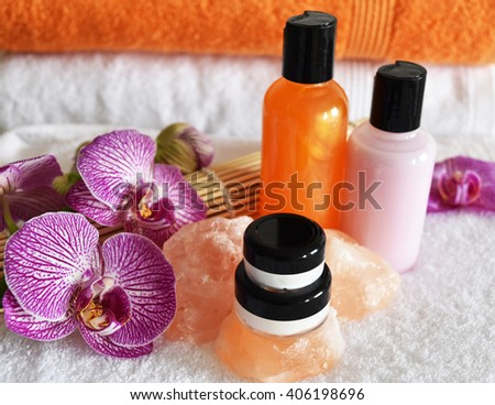 Various jars and bottles of skin care products with orchid flower. spa concept.