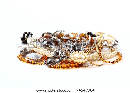 Various jewellery and accessories on white background
