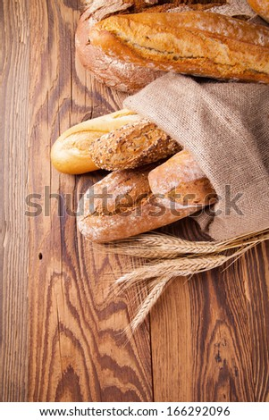 various kinds of bread on wood - stock photo