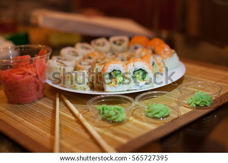 Various kinds of Classic Japanese sushi Set nigiri and rolls with ginger and avocado on a & Various Kinds Classic Japanese Sushi Set Stock Photo (Safe to Use ...