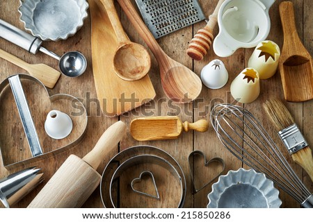 various kitchen utensils on wooden table - stock photo