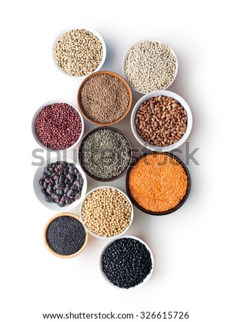 various legumes in bowls on white background - stock photo