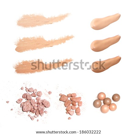 Various make-up powder isolated on white - stock photo