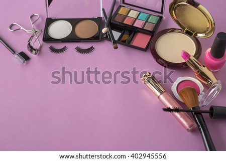 Various makeup products on dark background with copy space,original color tone