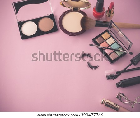 Various makeup products on dark background with copy space (Vintage with pink toned Style Color) - stock photo