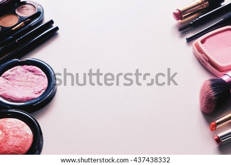 Various makeup products on white background with copy space effect tone. solf focus - stock photo