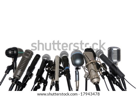 Various microphones aligned at press conference isolated over a white background - stock photo
