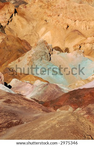 Various mineral pigments have colored the volcanic deposits found here. - stock photo
