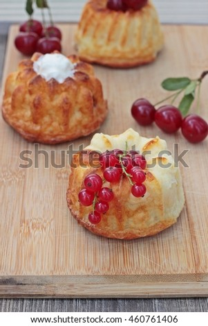 Various mini cheesecake with berries. Cottage cheese casserole
