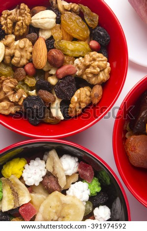 various mix dried fruits and nuts on the white background