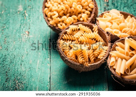 Various mix of pasta on wooden rustic background. Diet and food concept. - stock photo