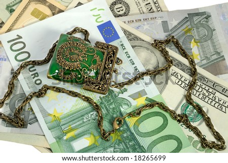 Various money and decorative purse with a chain - stock photo
