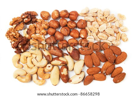 Various nuts over white background, horizontal image