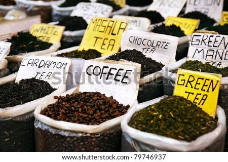 Various of Indian spices on the Anjuna flea market in India, Goa. Masala tea, coffee, cardamom tea, green tea, white tea, chocolate tea etc - stock photo