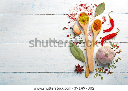 Various of spices on wooden background - stock photo