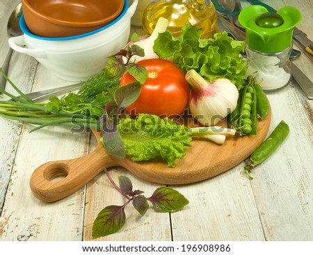 Various of vegetables and herbs on a wooden background - stock photo