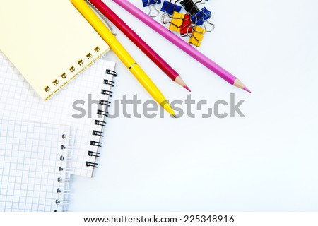 various office supplies in order on the  white background - stock photo