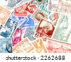 Various old postage stamps. Collectible postmarks. Old collection related to mail. - stock photo