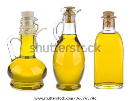 Various olive oil bottles isolated on white background - stock photo