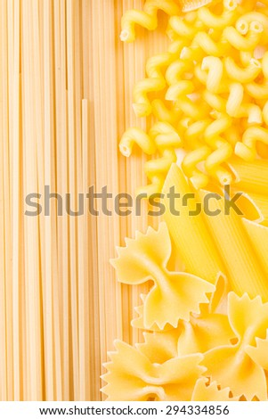 Various pasta  types as a background on the table - stock photo