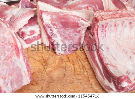 various pieces of meat on a cutting table - stock photo