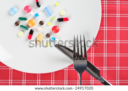 Various pills on a plate - stock photo