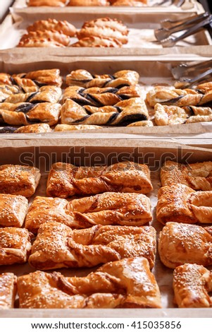 Various Puff pastry, Croissants, buns and pies on shelf in Bakery shop. Pastries in a bakery