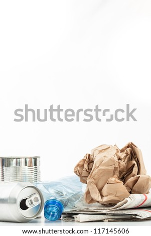 Various recyclable waste on white background - stock photo