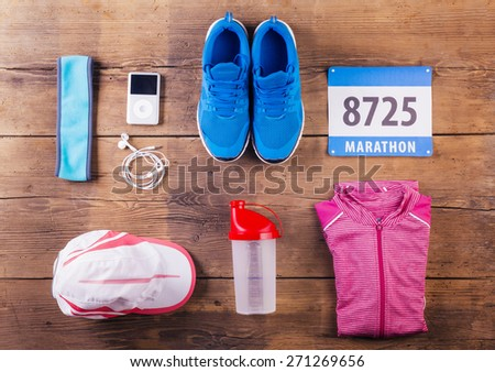 Various running stuff lined up on a wooden floor background - stock photo
