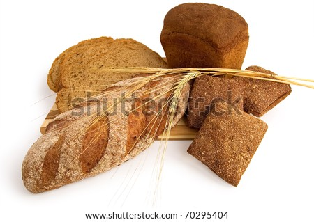 Various rye bread with a wooden board with stems of rye isolated on a white background - stock photo