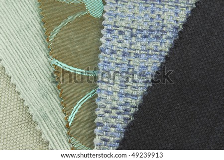 various samples of fabric choice in blue color and texture - stock photo