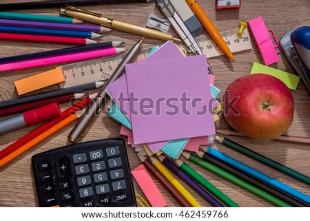 various school items on wooden background