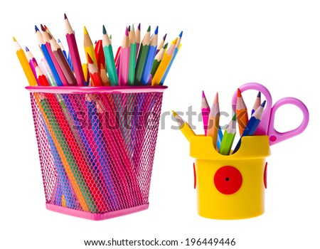 Various school supplies in basket and holder isolated on white - stock photo