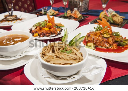 Various selection of chinese meals on table in restaurant - stock photo