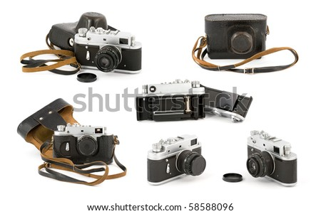 Various shots of a vintage analog film camera. Isolated on pure white background. - stock photo