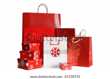 Various sizes of holiday shopping bags and gift boxes on white background - stock photo