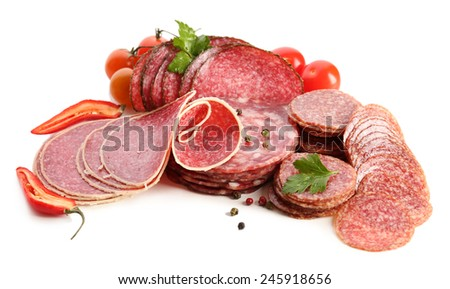 Various sliced salami with chili pepper, cherry tomatoes and spices isolated on white background - stock photo