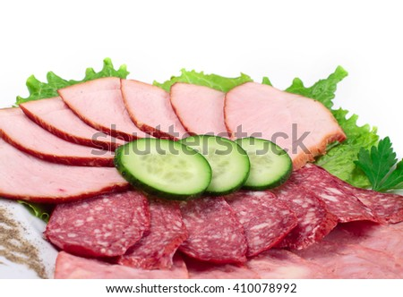 various sliced sausages with vegetables - stock photo