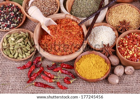 Various spices and herbs on a sack cloth